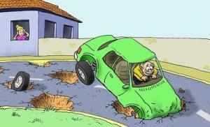 danos causados por buracos na rua